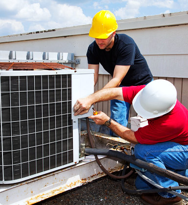 two man repairing aircon