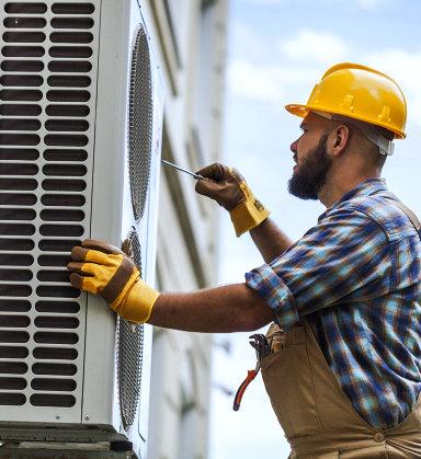 man fixing aircon