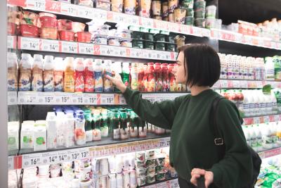woman picking drinks at refrigerator